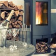 Festive home interior wirh champagne, two glasses and fireplace — Stock Photo #54092137