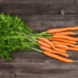 Fresh carrots over wooden background. Vegetable. Food — Stock Photo #54092321