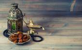 Dates, arabian lantern and rosary. Islamic holiday — Stock Photo
