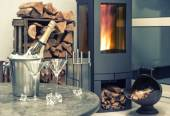 Festive home interior wirh champagne, two glasses and fireplace — Stock Photo
