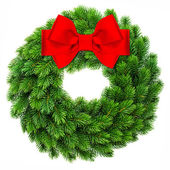 Christmas decoration evergreen wreath wit red ribbon bow — Stock Photo