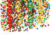 Colorful party decoration with confetti and shiny streamer — Stock Photo