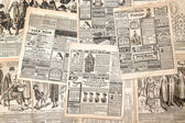 Newspaper pages with antique advertising. Woman's fashion magazi — Stock Photo