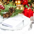 Christmas table place setting with red and gold decorations — Stock Photo #54546685