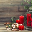 Christmas decoration with red candles and cinnamon cookies — Stock Photo #54546975