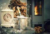 Home interior with champagne, antique clock and fireplace — Stock Photo