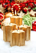 Christmas decoration with four golden burning candles — Stockfoto