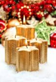 Christmas decoration with four golden burning candles — 图库照片