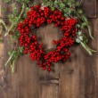 Christmas tree branches and wreath from red berries — Stock Photo #56531681