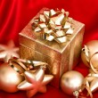 Golden christmas balls and gift box. festive decoration — Stock Photo #56531967