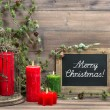 Vintage christmas decoration red candles and pine branch — Stock Photo #56532809