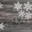 Christmas decoration white snowflakes on wooden background — Stock Photo #56535917