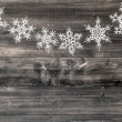 White snowflakes on wooden background. christmas decoration — Stock Photo #56535959