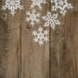 White snowflakes on wooden background. christmas decoration — Stock Photo #56536115