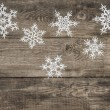 Christmas decoration snowflakes on rustic wooden background — Stock Photo #56536457
