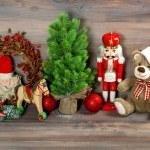Christmas decoration with toys teddy bear and nutcracker — Stock Photo #56538491