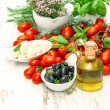 Fresh basil, tomatoes, mozzarella and olive oil. caprese salad i — Stock Photo #56538751