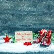 Christmas decoration red stars and antique baby shoes in snow — Stock Photo #56539691