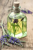 Bottle of lavender oil with fresh flowers. healthy herbs — Stock Photo