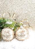 Golden christmas ball with christmas tree branch — Stock Photo