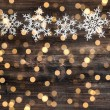 Christmas decoration snowflakes and defocused lights — Stock Photo #56540087