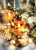 Christmas decoration with candles, lanterns and golden lights — Stock Photo