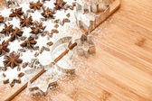 Cinnamon stars and cookies cutters. christmas sweet food — Stock Photo
