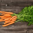 Fresh carrots over wooden background. Vegetable. Food — Stock Photo #57291609