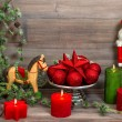 Christmas decorations with red candles, baubles, antique toys — Stock Photo #57292109