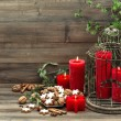 Christmas decoration with candles, cookies and pine branch — Stock Photo #57292465