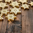 Christmas decoration snowflakes and on rustic wooden background — Stock Photo #57293719