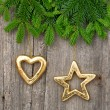 Christmas tree branch with golden decorations — Stock Photo #57294159