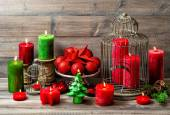 Christmas still life with burning candles and red baubles — Stock Photo