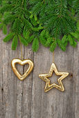 Christmas tree branch with golden decorations — Fotografia Stock
