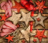 Christmas decorations wooden stars and red ribbons — Stock Photo