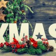 Christmas decorations and letter XMAS with pine tree branches — Foto de Stock   #57300231
