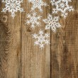 White snowflakes on wooden background. christmas decoration — Stock Photo #57300983
