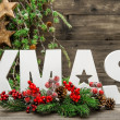 Christmas decorations and letter XMAS with pine tree branches — Foto de Stock   #57301243