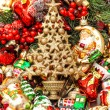 Golden christmas tree with baubles, toys and ornaments — Stock Photo #58876515