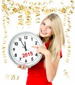 Young woman with big clock and party decoration. partytime 2015 — Stockfoto