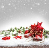 Nostalgic christmas decoration with antique baby shoes — Stock Photo