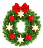 Christmas wreath decorated with red and golden ornaments — Stock Photo