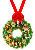 Christmas wreath decorated with ornaments and red ribbon bow — Stock Photo