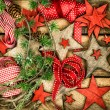 Christmas decorations wooden stars and red ribbons for gifts wra — Foto Stock #58916003
