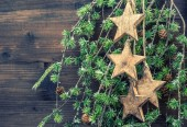 Christmas decorations wooden stars and pine tree branches — Stock Photo