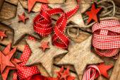 Christmas decorations wooden stars and red ribbons — Foto de Stock