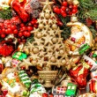 Golden christmas tree with baubles, toys and ornaments — Stock Photo #58961671