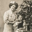 Happy mother and daughter with christmas tree and antique toys — Stock Photo #58977885