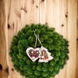 Traditional christmas wreath on wooden background — Stock Photo #58978083