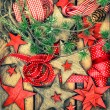 Christmas decorations wooden stars and red ribbons. retro style — Foto Stock #58978669